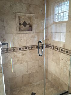 My bathroom renovation! Travertine tile and custom, frameless shower doors. Oil rubbed bronze fixtures.