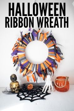 Create an easy and beautiful Halloween Ribbon Wreath in traditional holiday colors with this simple tutorial! #halloween #halloweenwreath #ribbonwreath #wreath #homedecor #holidaydecor #doordecor #craftsbyamanda