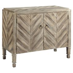 Perfect for holding extra table linens in the dining room or board games in the den, this 2-door cabinet showcases a plank-style chevron design.  ...