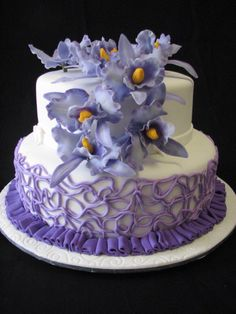 Purple themed wedding cake with handmade sugar orchids