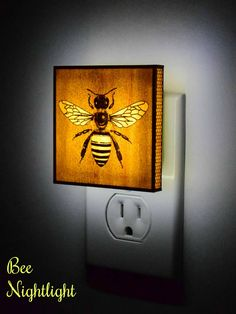 The Bee Night Light. Ultra-thin wood is laser cut and sealed with polyurethane. It is then fixed to a plexiglass plate and attached to a custom LED light #ad #Etsy #bee #bees
