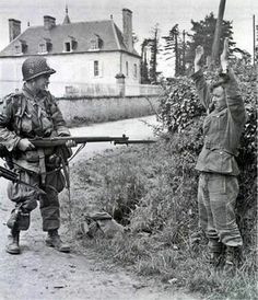 Prisoner of war: German soldier surrending to US Paratrooper, WWII, Normandy. Ww2 History, Military History, World History, World War Ii, Nagasaki, Hiroshima, Vietnam, History Online, War Photography