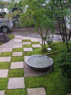 Collaboration of checkered hardscape, gravel, moss and water bowl. Niigata City Akiba District, Japan.