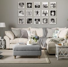 love the white frames with black/white photos against the grey wall.