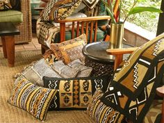 "African Textiles used on pillows. The abstract, symbolic designs greatly influenced early European ""modern"" artists of last century."