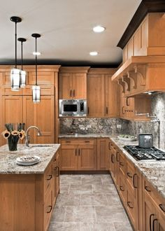 Love the countertops, the pendant lights, and the color of the cabinets.  IMHO, white is not a good cabinet choice, because if you cook a lot, they look dirty too quickly.  I think that the backsplash needs to be a different color, something darker, to jazz it up a bit.