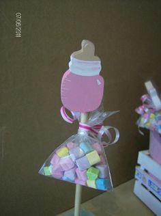 Usa dulces, caramelos o chocolates para obsequiar como recuerdo o souvenir en un babyshower. Puedes utilizar diversos recipientes, bolsas o...