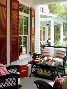 Porch. LOVE the wood shutters!