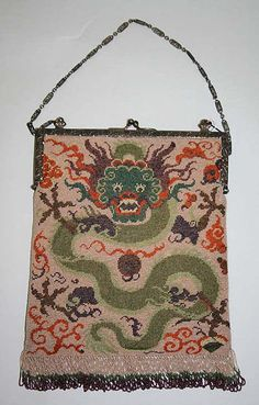 Purse, 1920s, American or European. This beaded purse obviously has an oriental inspiration to it with the dragon cascading down the front. The fringe on the bottom went along with the fringed flapper dresses of this time.