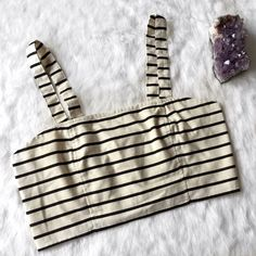 """Ecoté Black and Cream Striped Crop Top NWT Ecoté Bralette from Urban Outfitters •Perfect Condition  •True size Large 36A-D •Adjustable Straps •49% Polyester, 36% Cotton, 10% Rayon, & 5% Linen •Measurements taken flat 15.5"""" Bust (pit to pit) 8"""" in length (center down) Urban Outfitters Tops Crop Tops"""