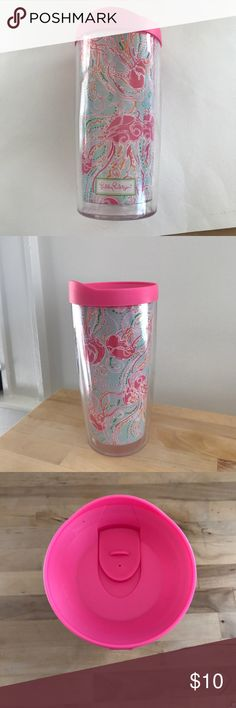 Lilly Pulitzer Drink To-Go Holder Plastic to go container with Lilly Pulitzer Print. The cap has a small dot on it but it is in the material and the back of the cap looks like it had something connected to it but it's no longer there. Bought at warehouse sale, never used and besides those two small things it is in perfect condition! Drink in style! Lilly Pulitzer Accessories