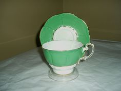 Paragon tea cup and saucer green, white and gold no.191429/1