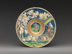In Virgil's Aeneid, humans are subject to the whims of the gods. This bowl belongs to a service featuring characters from the tale, and the artist ingeniously used the bowl's divided surface to depict the dual realms of heaven and earth