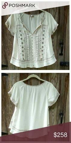 """NWOT Joie Alissa Embroidered Top Lovely ivory silk top with allover embroidery, V-neck with tassel ed tie, shirttail hem and flutter sleeves. Relaxed fit, trapeze shape. Length from shoulder 23"""", width at bust 17.5"""". 100% silk, dry clean. Color is as shown in first three photos; last photo for modeling purposes only. Joie Tops Blouses"""
