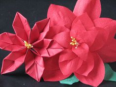 Pretty little origami poinsettias. I just made some for gift decorations - super easy and super pretty. Also has a ton of other hand made ornament ideas.