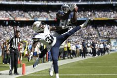 Dallas Cowboys wide receiver Dez Bryant leaps over San Diego Chargers defensive back Richard Marshall to catch a touchdown pass. (AP Photo/Gregory Bull)