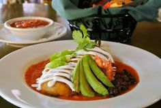 Menu Item: Chile Relleno has a roasted poblano chile stuffed with Monterey Jack cheese, deep fried and topped with fresh pico de gallo, avocado & lime sour cream, accompanied by black bean chili.