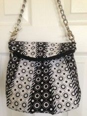 this black & white Uptown Saddlebag was created by Andrea Smith of Austin, TX. She incorporated a chain strap so she could move it from bag-to-bag, which is a terrific idea  October 2013 Handbag of the Month Contest | Studio Kat Designs
