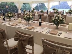 Long dining tables in cappuccino and cream with hessian tie backs