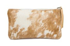 Add the perfect touch of bohemian cool to your outfit with this beautifully handmade clutch. www.mooreaseal.com