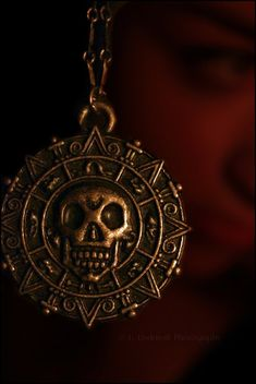 Pirates of the Carribean: The Curse of the Black Pearl medallion. Referencing Peter Dundas' s/s 2012 collection for Pucci