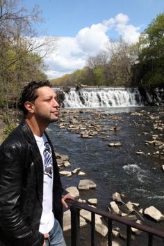 """Just a stone's throw from the Bronx Zoo's Boston Road entrance is River Park, a summer BBQ hot spot and home to a bank of waterfalls. 'This is the spot to hang out in the summer — and Pelham Park,' says Rob, adding that local kids and daredevils sometimes dive from the top of the falls. 'There have been a couple of accidents where kids have gotten hurt,' he says."" Credit: Jefferson Siegel for New York Daily News. In ""An insider's guide to West Farms, the Bronx,"" Daily News, 24 Apr. 2012."