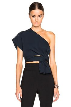 Try a fun one-shoulder top paired with black pants for a night out this spring. Let Daily Dress Me help you find the perfect outfit for whatever the weather! dailydressme.com/