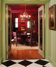 Checkerboard painted over hardwood floors Credit - John Buscarello, Designer