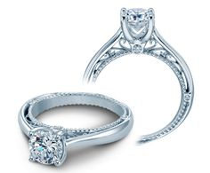 Don't let the illusionary look of the Venetian 5047R diamond engagement ring fool you. Classic and clean on the outside, the inside band showcases the filigree-like design and antique beading that will make this ring deceptively intricate.