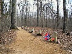 Along a section of the old Natchez Trace just north of Tupelo can be found the graves of thirteen unknown Confederate soldiers. No one knows who these men are, other than that they were buried in a line on a small hill overlooking the trace.