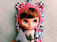 Quilted sleeping bag carrier for Blythe doll  Designed and hand made by me... Padded with wool batting, quilted in Cath Kidston soldier print. Fully lined in polka dot soft cotton. Cute bear ears and a handle to hang your Blythe doll up. Closes with four fabric covered buttons by me in the same fabric.   Comes complete with padded face protection in the same material and lining, fastens at sides with four buttons & handmade cotton loops.  Comes complete with care instructions.  Will fit ...