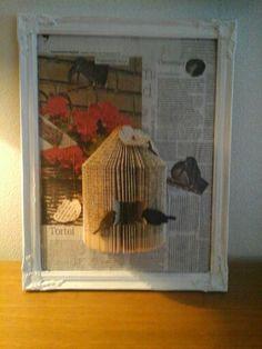 Boekenknutsel  vogelhuisje op lijst
