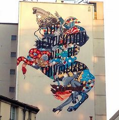 """Tristan Eaton has landed in Paris, France where he was invited by Be Street to paint for the latest edition of the Nuit Blanche Festival. Painted over a period of four days, the American street artist employed his unique aesthetics to create a beautiful piece that encompasses a variety of textures and styles. The piece is based on the iconic """"Napoleon Crossing the Alps"""" painting by Jacques-Louis David and the text reads """"The Revolution Will Be Trivialized""""."""