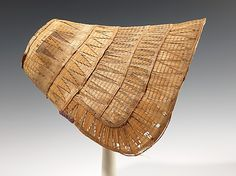 Straw poke bonnet, American, ca. 1835. Because of its inherent fragility, the intricate fancy weave worked on this bonnet is rare, as examples like this usually do not survive. The striking color and design of the straw added an additional decorative touch to the bows, corsages, and ruffles that would have originally decorated the bonnet.