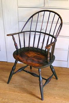 """Georgian: 'Sack Back' Windsor Chair produced in Philadelphia, PA. Oval seat made of 2"""" thick pine. The arm rail and curved splat back are all native red oak. The legs and spindles are maple.   http://www.windsorchairs.biz/windsor-chair-01.html"""