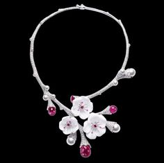 Piaget - Limelight Garden Party necklace   A magical necklace in which finely worked cherry blossoms rest delicately on a garland of diamonds. The subtle blend of colors features pink sapphire and white chalcedony. All is freshness and femininity, radiance and pure luxury. When flowers dazzle like jewels and light metamorphoses into garlands of diamonds, the garden party can begin.