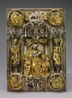 ..Title (object)The Ulm Münster Book-Covers DescriptionCover of book of the Gospels; silver; parcel gilt; ornamental designs in high relief; centre: Virgin and Child; her cloak supported by two angels with two other angels holding crown above her head; whole beneath canopy of two intersecting arches, with pinnacles and intersecting columns, seated angel at capital of each; St John the Almoner .ca 1500