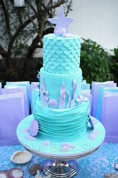 Mermaid Cake Under the Sea Cake Aqua Blue and Lavender Cake with fondant mermaid scales, purple starfish topper, sea shells and seaweed and fondant ocean waves.