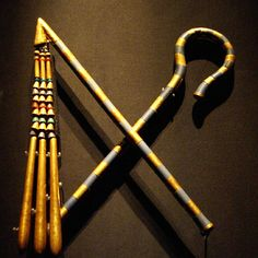 Flail and Crook, Royal Symbols from Tutankhamun's Burial are made of gold, copper alloy, glass, wood and carnelian.