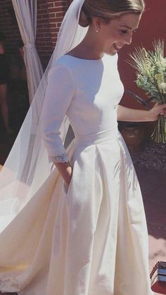 Classically styled wedding gown wedding dress with simple elegance # . Classically styled wedding gown wedding dress with simple elegance dress Designer Wedding Gowns, Designer Dresses, Gown Designer, Modest Wedding Dresses, Bridal Dresses, Dress Wedding, Wedding Dress Pockets, Wedding Dress Simple, Classic Wedding Dress