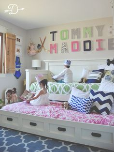 A mix of colors and patterns, and a dual hockey and dance theme, combine to make this bedroom truly a shared space for both our dear son and dear daughter that any brother and sister would love!