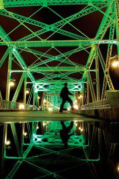 Green lights glow on the Shelby Street Pedestrian Bridge in Nashville, TN. Find more on green living in Nashville...