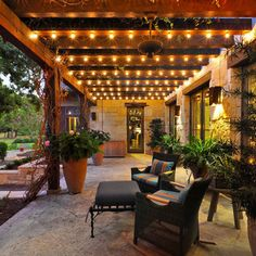 String lights used as a creative alternative to outdoor fixtures. Creates a beautiful glow! Get your custom length stringers to fit your space: http://www.partylights.com/Commercial-String-Lights/Commercial-C9-String-Lights-Bulbs