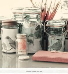 Printed paper or scrapbook paper displayed in mason jars...such a simple & cute idea and possible DIY!