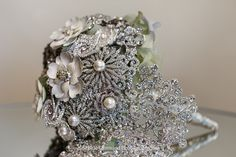 Couture CollectionAll Couture work is custom; every piece ends up being one of a kindCouture CasadeUnique Cascades Swarovski Elements and Australian crystals Unique metal flower designs Brooch Bouquets, Flower Brooch, Bunch Of Flowers, Metal Flowers, Flower Designs, Swarovski, Wedding Day, Jewels, Bridal