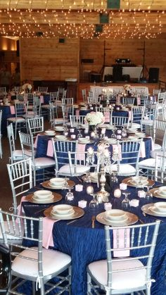 Navy blue, silver, and blush pink wedding. Candelabras, flowers, charger plates.