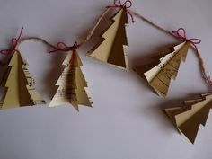 cute folded paper Christmas tree garland on Etsy.