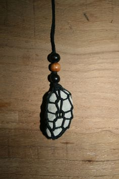 Spider Web Enshrouded Hag Stone Pendulum.  Sea Moon Magick.  Handmade in France by Mel Spidertree In my Etsy shop now. https://www.etsy.com/shop/SpidertreeEmporium #hagstone #pendulum #divination #seawitch #witch #witchcraft #pagan #wiccan #magick