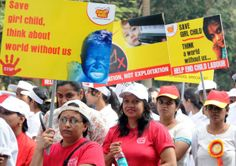 Euro Kids members and teachers take part in an awareness rally on various child related issues on Children's Day in Bangalore on Nov.14