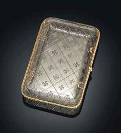 A GEM-SET, ENAMELLED GOLD-MOUNTED ROCK CRYSTAL CIGARETTE CASE BY FABERGÉ, WORKMASTER MICHAEL PERCHIN, ST PETERSBURG, CIRCA 1890. Rectangular with rounded corners, the rock crystal cover and base engraved overall with a floral chequered pattern, the gold mount enamelled with green and white guilloché motif over a stippled ground, with rose-cut diamond-set push-piece.